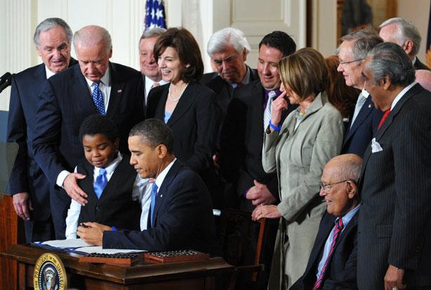 Obama+signing+health+care+bill