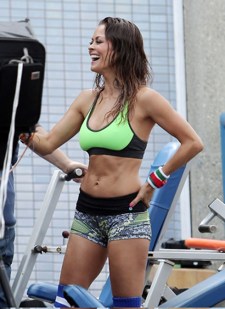 Brooke Burke-Charvet shows off her toned figure while shooting a new Sketchers advertisement at an outdoor gym in Los Angeles