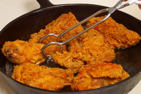 Fried Chicken Cooking in a Frying Pan