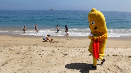 Man dressed in a condom costume walks at Caleta Portales beach, during a summer awareness campaign by the Chilean Corporation for the Prevention of AIDS in Valparaiso city