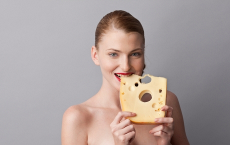 woman eating swiss cheese