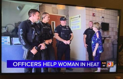 OfficersHelpWomanInHeat
