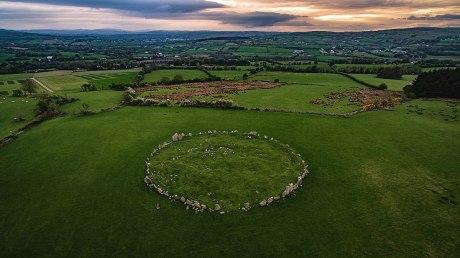 1200px-Beltony_stone_circle_at_sunset.jpg